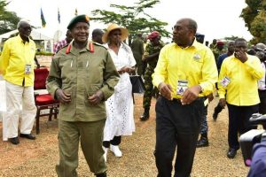 President Museveni shares a light moment with Prime Minister Rugunda
