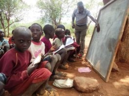 Class three Pupils at Nachuru primary school in Tiaty sub-county in Baringo County seated on stones while taking their lessons under a tree on on January 16,2016.//JOSEPH KANGOGO