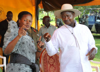 File Photo:President Museveni talking to Kayunga district MP Nantaba at a rally at Nekoyedde, He donated a maize mill to each parish in Kasaana Sub County