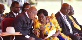 Filephoto: FDC's Betty Anywar consults President Museveni.