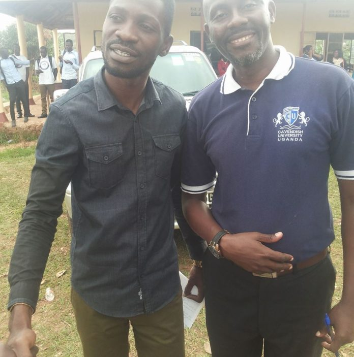 Baguma Richard with Hon. Bobi Wine