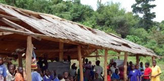 File photo: UPE pupils in a dilapidated classroom structures at a school on Buvuma Islands