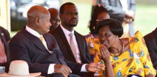 File photo: President Museveni chats with FDC's Beatrice Anywar, the Kitgum municipality MP,