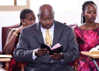 file photo: President Museveni reading his Bible during the Christmas service