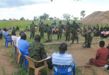 file photo:Soldiers guard private farms in Nwoya