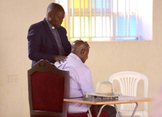 File photo: Rev Fr John Baptist Bashobora, the Coordinator of the Charismatic Renewal Movement prays for President Museveni