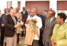 Museveni admires a Cardigan and Socks from Sigma Knitting industries Ltd