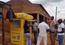 Mobile money customers making transactions
