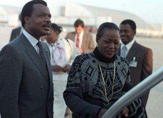 Denis Sassou-Nguessou, president of the People's Repubic of the Congo, left, boards his aircraft to leave the country.