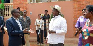 File photo: Buganda Katikiro CP Mayiga stresses a point to Pres Museveni